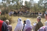 As we renew our baptism vows. others across the River Jordan - actually in Jordan - are baptised