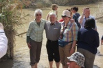Pilgrims from St Mary's Lewisham paddle in the Jordan